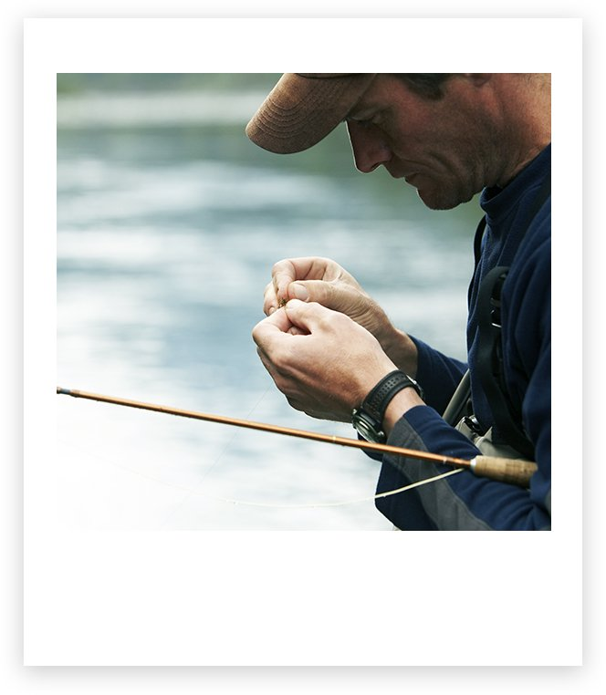 Man putting bait on a fishing line