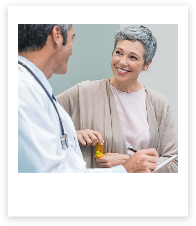Doctor speaking with smiling patient speaking